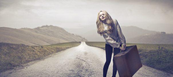 bigstock-Beautiful-woman-carrying-a-sui-30688583 [420178]